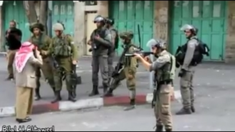 The PaElderly Palestinian man confronts armed Israeli soldiers to stop them from shooting Palestinians, before he collapses.