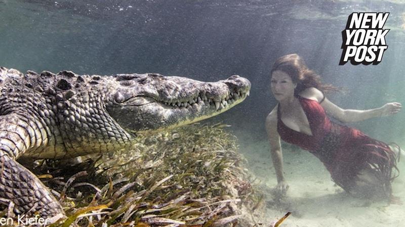 Brave models swim in crocodile-infested waters for perfect shot