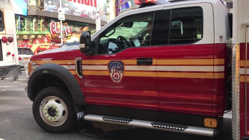 BRAND NEW FDNY EMS AMBULANCE RESPONDING IN HEAVY TRAFFIC ON 8TH AVENUE IN HELLS KITCHEN, MANHATTAN.