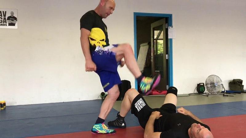 Clam defense vs jumping stomping kick, with Amnon Darsa at Expert, Institute Krav Maga Netherlands.